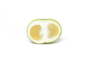 Oroblanco Grapefruit Cut In Half On White Background