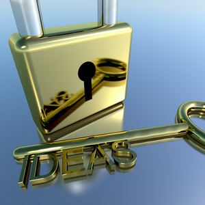 Padlock With Ideas Key Showing Improvement Concepts And Creativity