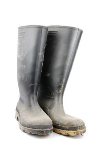 Pair Of Black Rubber Boots On White