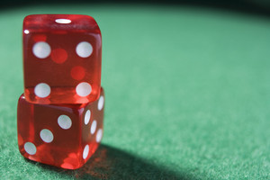 Pair of dice against green baize