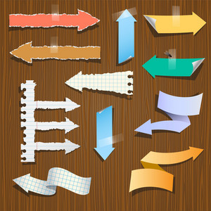 Paper Arrows On Wooden