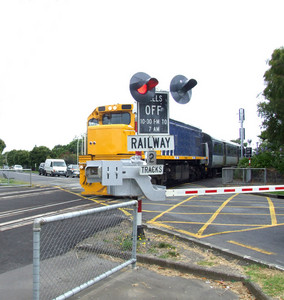 Passenger Train At Crossing