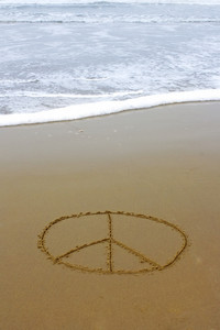 Peace Sign Drawn On Beach