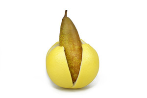 Pear In A Grapefruit Peel On White Background