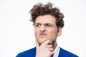 Pensive businessman in glasses over white background