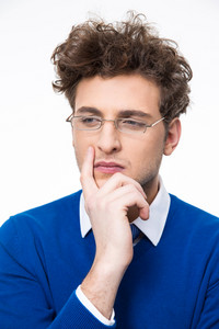 Pensive young businessman in glasses looking away