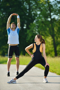 People Doing Stretching Exercise  After Jogging