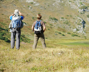 People enjoying walking in mountains