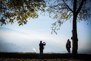 People in beautiful park with city view