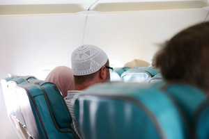 People in plane traveling