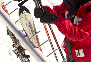 Person Holding Ski Equipments