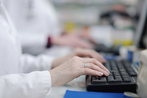 Pharmacist woman typing