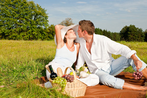 Picnic - Romantic couple in spring nature on sunny day