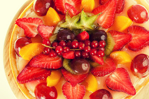 Pie with fruits and berries covered with jelly