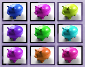 Piggy Banks On Monitors Showing Savings