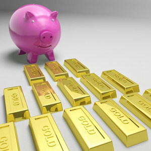 Piggybank Looking At Gold Bars Showing Gold Reserves