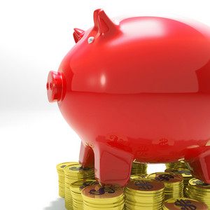 Piggybank On Coins Shows Financial Balance