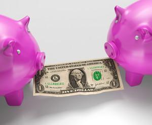 Piggybanks Eating Money Showing Monetary Loses