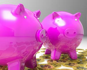 Piggybanks On Pound Coins Shows Britain Finances