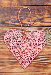 Pink hearts on grunge wooden background