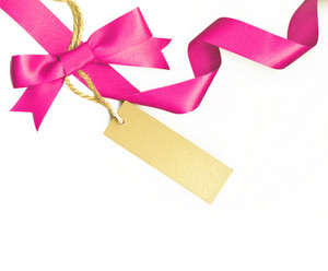 Pink Ribbon With A Label Isolated On White