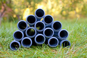 Pipes stacked on the grass