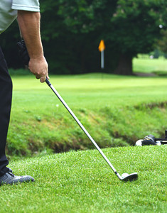 Pitching A Golf Ball Onto The Green