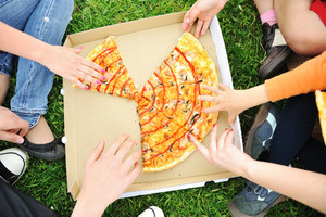 Pizza family picnic, eating outdoor together