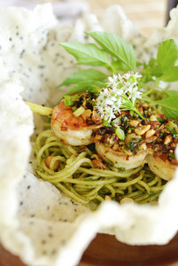 plate of green spaghetti broccoli pesto and prawn ready for serving