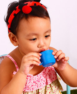 Play Acting With A Toy Cup