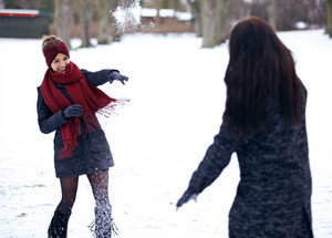 Playful Women Playing in the Snow Outdoors