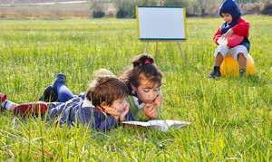Playing and reading on meadow