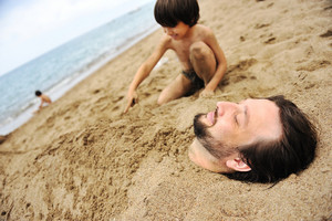 Playing with sand and digging the father in