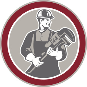 Plumber Holding Giant Wrench Woodcut Circle