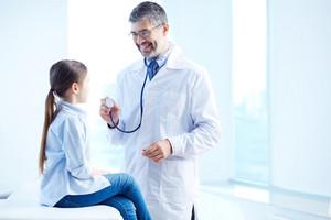 Cute girl having medical consultation in hospital