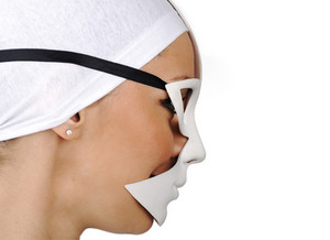 Portrait of a beautiful girl with white mask, profile