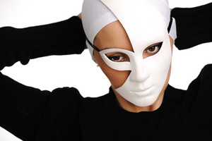 Portrait of a beautiful girl with white mask