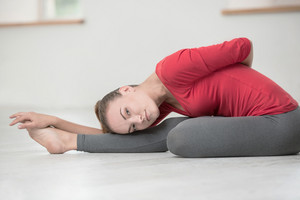 Portrait of a beautiful woman doing stretching exercises in gym