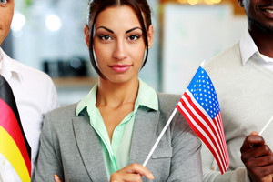 Portrait of a beautiful woman standing with USA flag