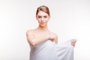 Portrait of a beautiful woman with towel isolated on a white background