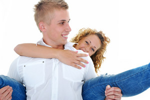 Portrait of a beautiful young couple smiling together piggybacking
