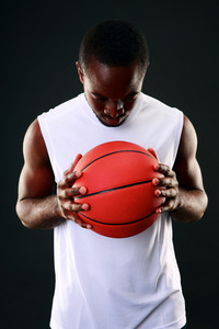 Portrait of a black man with backetball ball