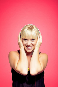 Portrait of a blonde teen with headphone listening to music