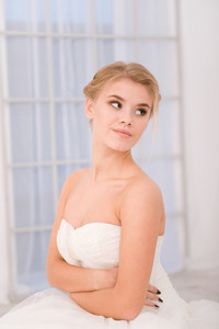 Portrait of a bride in white wedding dress looking away