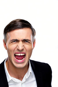 Portrait of a businessman yelling over white background