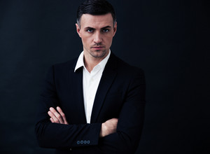Portrait of a confident businessman with arms folded