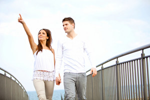 Portrait of a couple holding hands while walking outdoors