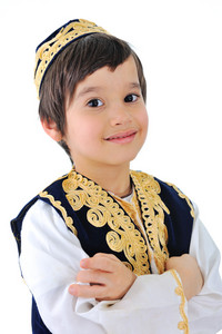 Portrait of a cute bosnian child wearing traditional clothes