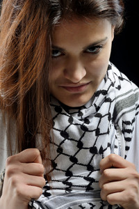 Portrait of a cute girl with a palestinian scarf