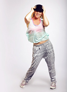 Portrait of a fashionable hip hop dancer in trendy clothing
